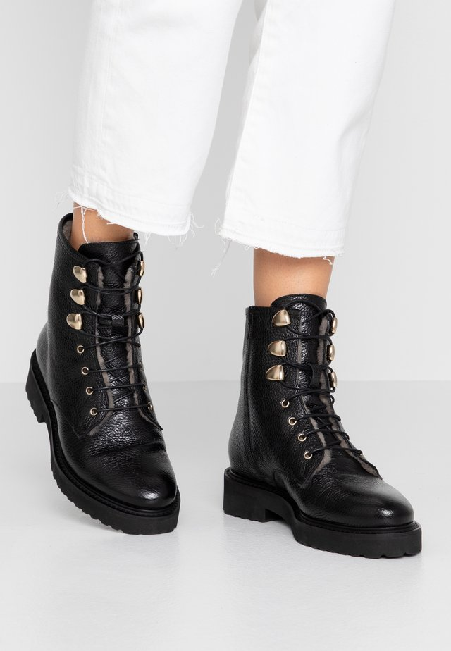 Lace-up ankle boots - bottero nero