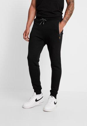 ROME  - Teplákové kalhoty - black