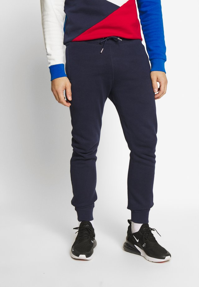 PRECUATIONS - Tracksuit bottoms - navy