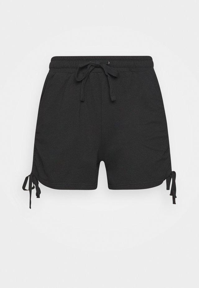 SHAPE SHIFTER - Korte broeken - black