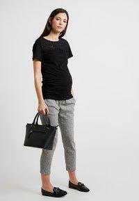 LOVE2WAIT - LOOSE PANT - Pantaloni - black - 1