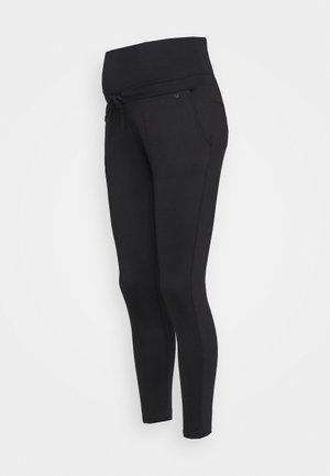 PANTS TRAVELLER - Trousers - black