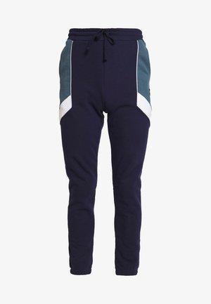 SPLICE TRACKPANT - Teplákové kalhoty - navy