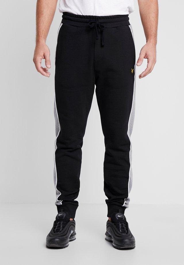 SIDE PANEL  - Teplákové kalhoty - jet black
