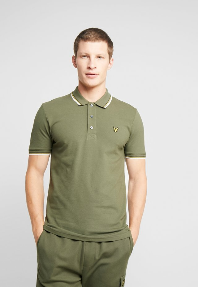 TIPPED - Poloshirt - olive/white