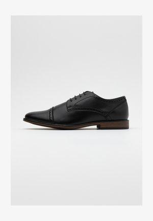 BRYANT BROGUE - Business sko - black