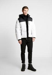 Burton Menswear London - SHIELD JOGGER  - Tracksuit bottoms - black - 1