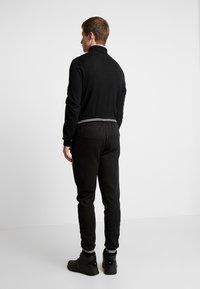 Burton Menswear London - SHIELD JOGGER  - Tracksuit bottoms - black - 2