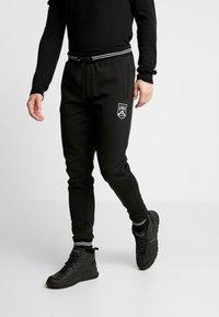Burton Menswear London - SHIELD JOGGER  - Tracksuit bottoms - black - 0