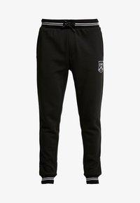 Burton Menswear London - SHIELD JOGGER  - Tracksuit bottoms - black - 3