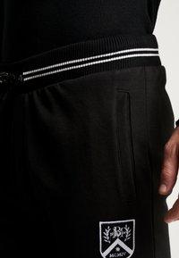 Burton Menswear London - SHIELD JOGGER  - Tracksuit bottoms - black - 4