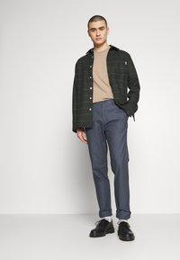 Burton Menswear London - SLIM TEXTYRED - Pantaloni eleganti - blue - 1