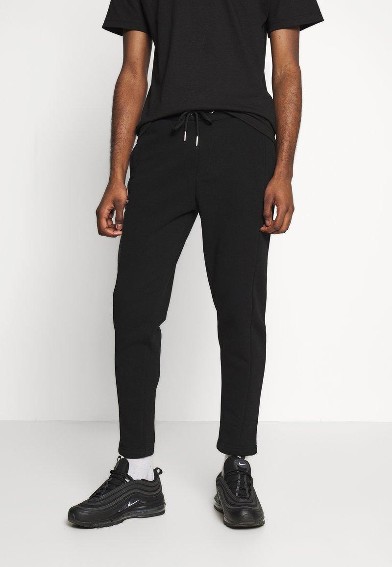 Burton Menswear London - Spodnie treningowe - black