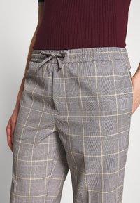 Burton Menswear London - TAPERED POW CHECK ELASTICATED - Trousers - grey - 3