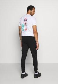 Burton Menswear London - CORE CARGO - Teplákové kalhoty - navy - 2