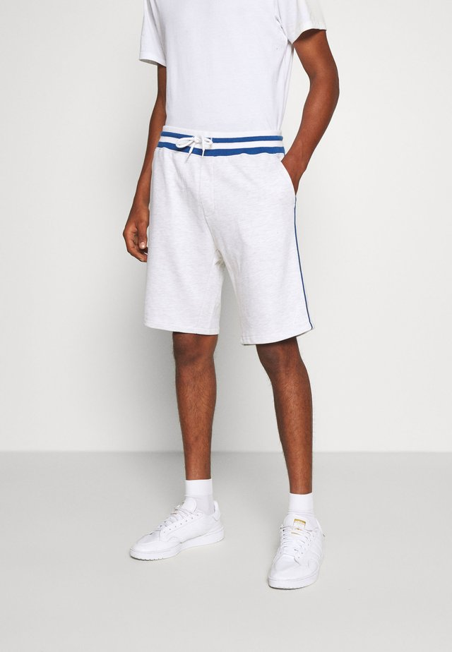 BASKETBALL - Tracksuit bottoms - white