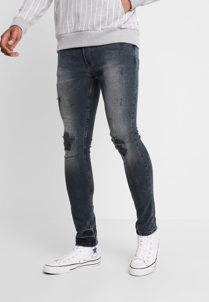 Burton Menswear London - OVERDYE  - Jeans Skinny Fit - navy blue