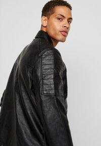Burton Menswear London - BLACK BIKER - Faux leather jacket - black - 6