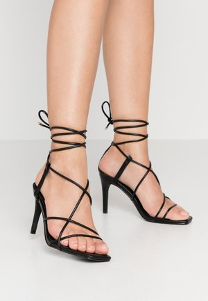 STRAPPY KNOTTED - Sandales à talons hauts - black