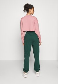 Missguided - SIGNATURE BASIC - Pantalon de survêtement - dark green - 2