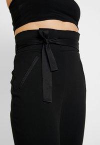 Missguided - FRIDAY PAPER BAG TIE WAIST CIGARETTE TROUSERS - Pantalones - black - 4