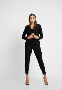 Missguided - FRIDAY PAPER BAG TIE WAIST CIGARETTE TROUSERS - Pantalones - black - 1