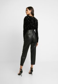 Missguided - LIGHT MAGIC STAR PLUNGE WRAP BODYSUIT - Top s dlouhým rukávem - black - 2