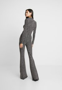 Missguided - LIGHT MAGIC SPARKLE STRIPED FLARED TROUSERS - Kalhoty - black - 2