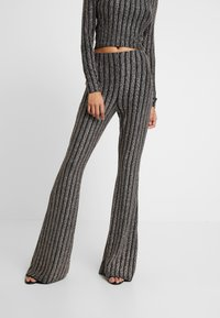 Missguided - LIGHT MAGIC SPARKLE STRIPED FLARED TROUSERS - Kalhoty - black - 0