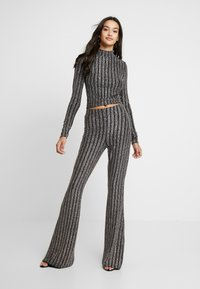 Missguided - LIGHT MAGIC SPARKLE STRIPED FLARED TROUSERS - Kalhoty - black - 1