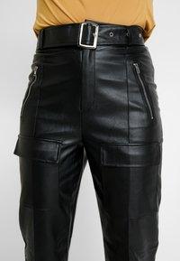 Missguided - JORDAN LIPSCOMBE PU HIGH WAISTED UTILITY TROUSER - Bukse - black - 6