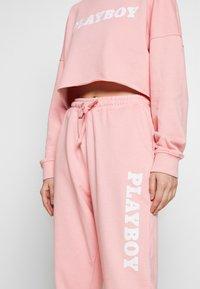 Missguided - PLAYBOY LOUNGE PANTS - Pantalon de survêtement - pink - 4