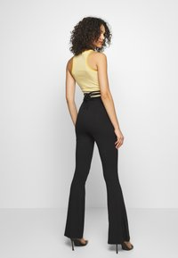 Missguided - TIE DETAIL FLARED TROUSERS - Leggings - black - 2