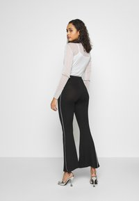 Missguided - CODE CREATE FLARE TROUSERS - Kalhoty - black - 3