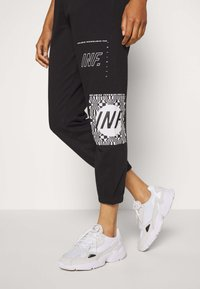 Missguided - GRAPHIC JOGGERS  - Tracksuit bottoms - black - 3