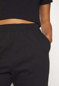 Missguided - GRAPHIC JOGGERS  - Teplákové kalhoty - black - 5