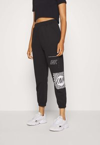 Missguided - GRAPHIC JOGGERS  - Tracksuit bottoms - black - 0