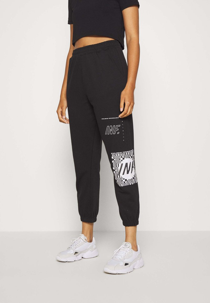 Missguided - GRAPHIC JOGGERS  - Tracksuit bottoms - black