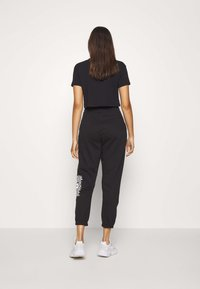 Missguided - GRAPHIC JOGGERS  - Tracksuit bottoms - black - 2