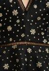 Missguided - LIGHT MAGIC GLITTER FLARED SLEEVES MAXI DRESS - Maxi dress - black
