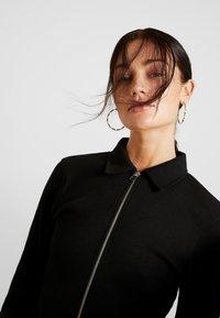 Missguided - POLO ZIP FRONT MINI DRESS - Vestido de tubo - black - 4
