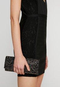 Missguided - PLUNGE BANDAGE PANELLED BODYCON DRESS - Sukienka letnia - black - 4