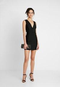 Missguided - PLUNGE BANDAGE PANELLED BODYCON DRESS - Sukienka letnia - black - 2