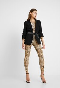 Missguided - HALLOWEEN LEOPARD PRINT SCOOP BACK - Jumpsuit - brown - 1