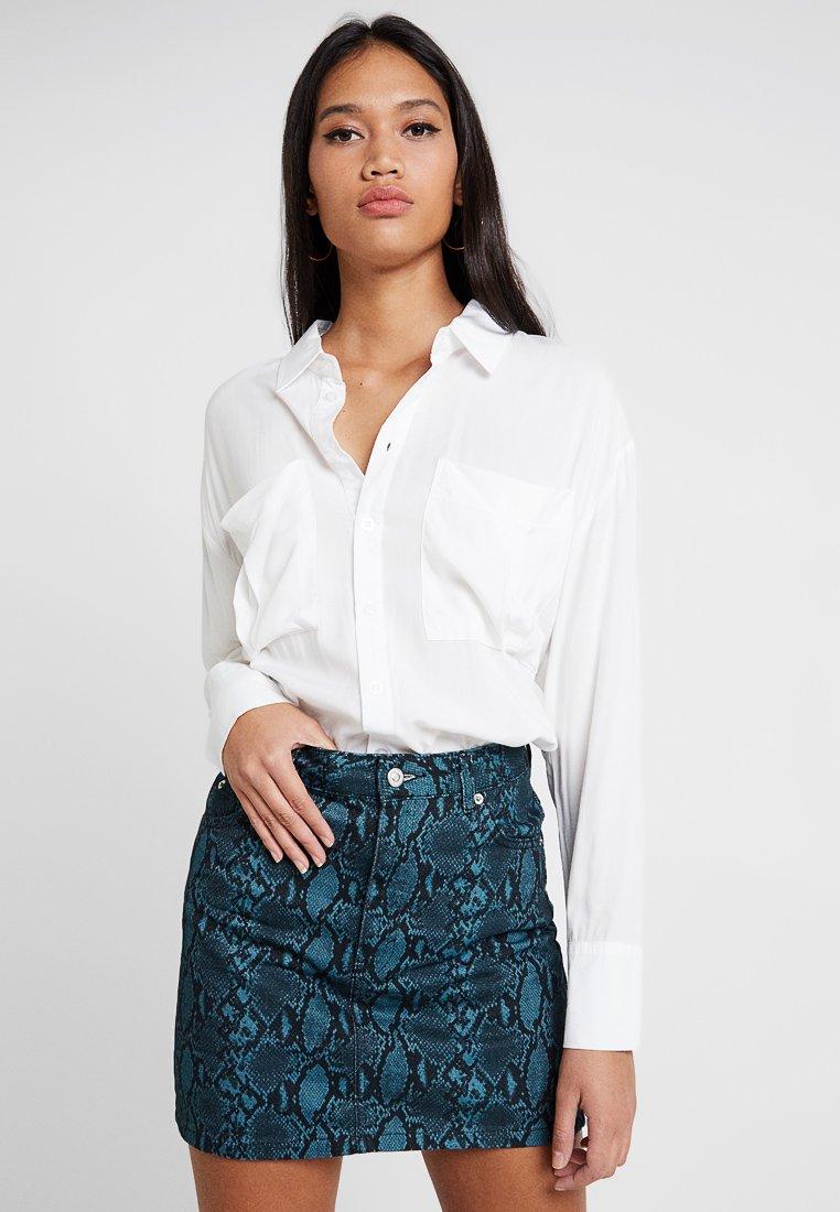 Missguided - SAFARI - Button-down blouse - white