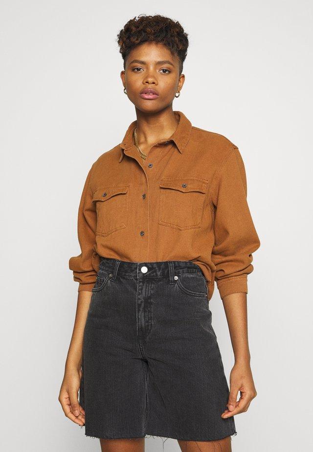 OVERSIZED DENIM SHIRT - Button-down blouse - camel