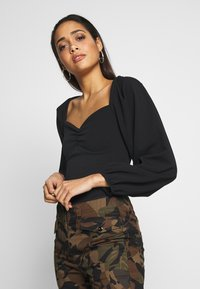 Missguided - EXTREME PUFF SLEEVE BODYSUIT - Blouse - black - 0