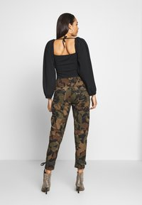 Missguided - EXTREME PUFF SLEEVE BODYSUIT - Blouse - black - 2