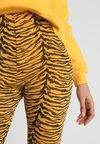 Missguided - ANIMAL PRINT CYCLE  - Shorts - orange