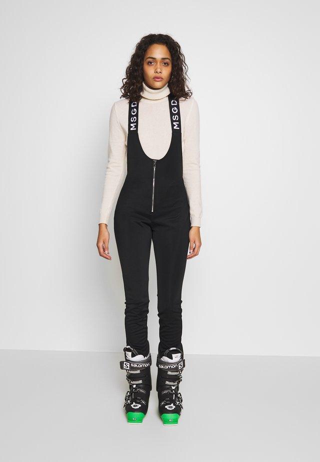 SKI SALOPETTES - Trousers - black